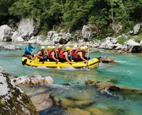 Adventurous break in the Soča valley, Group of people in the rafting in the Soča River
